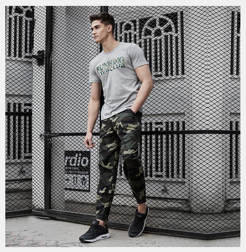 特步 男子梭织迷彩裤子2017春季新款 舒适轻便透气户外男运动裤883129499622-